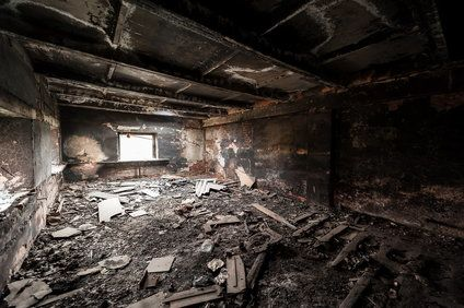 The interior of a home that has suffered significant damage due to a fire
