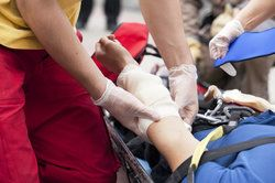 An injured person being tended to by emergency workers