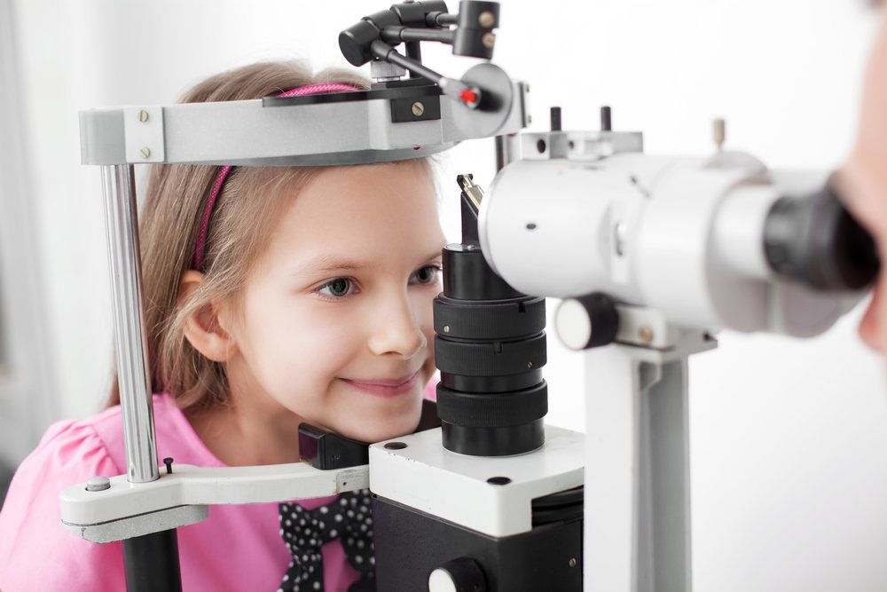 A young girl undergoing an eye exam