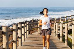 A woman jogging near the beach