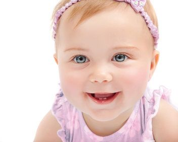 Smiling baby girl with blue eyes and red hair