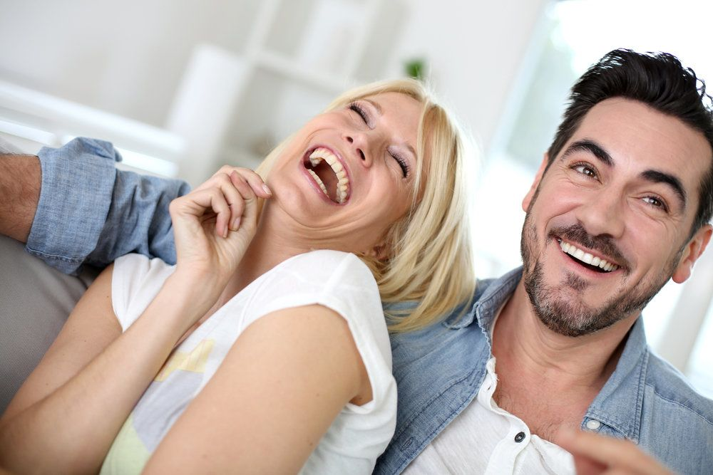 Laughing couple on the couch