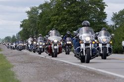 Many motorcyclists on the road