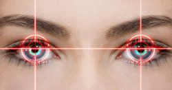 Woman's eyes with laser designs over them