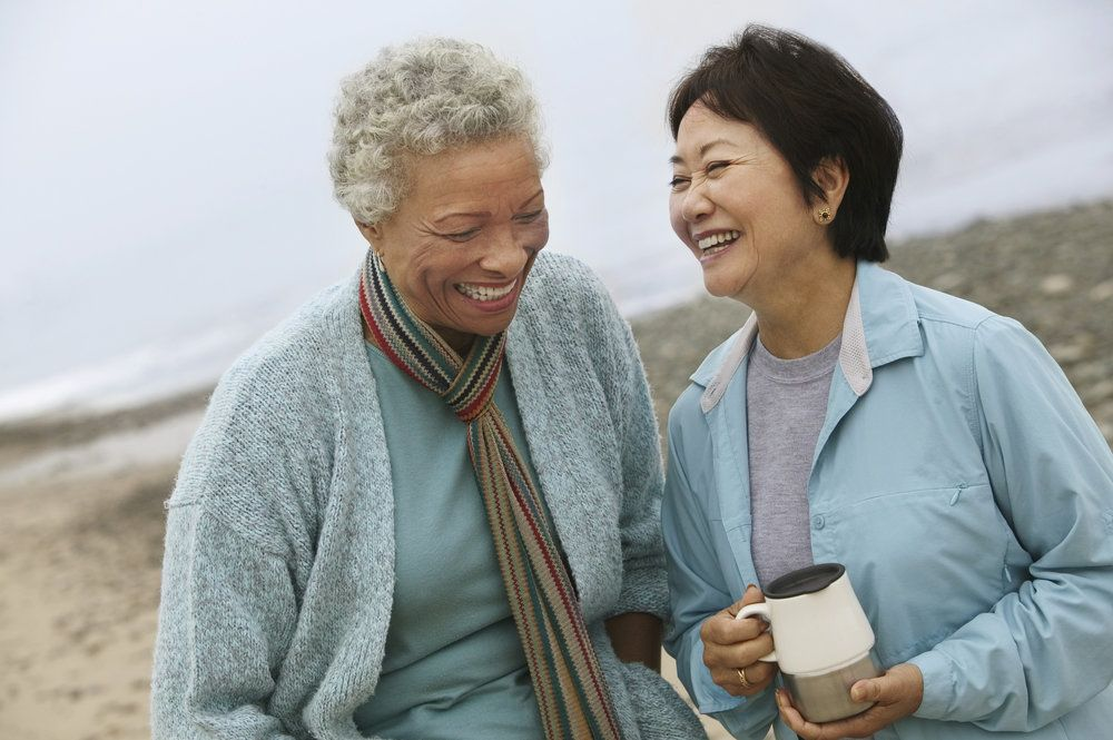 A pair of older women on the beach