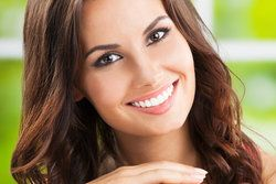 A young brunette woman with a beautiful smile