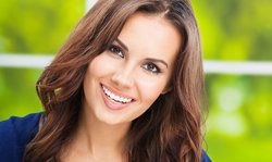 Attractive woman smiling and revealing bright, white teeth