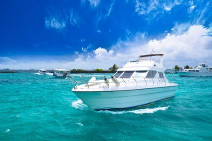 Sleek white boat sailing in turquoise waters
