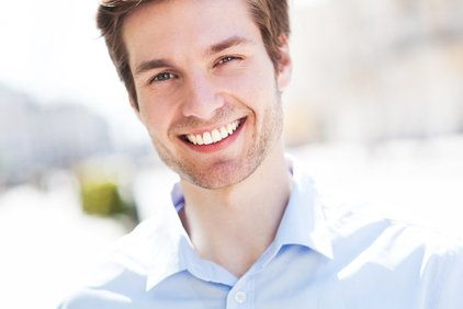Smiling man in blue button-up shirt