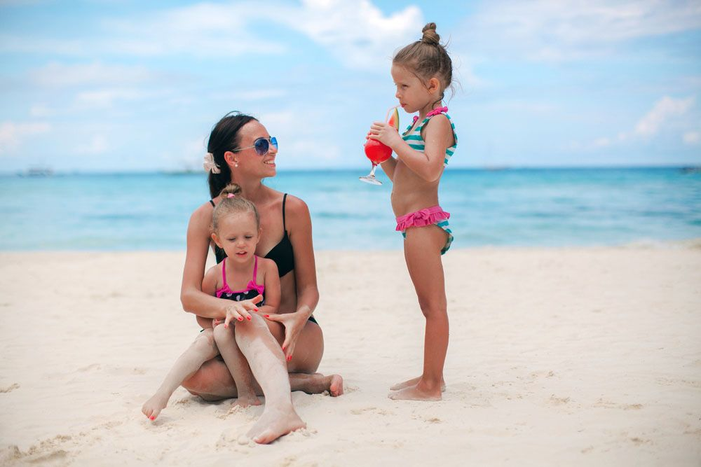 Children on the beach with mom