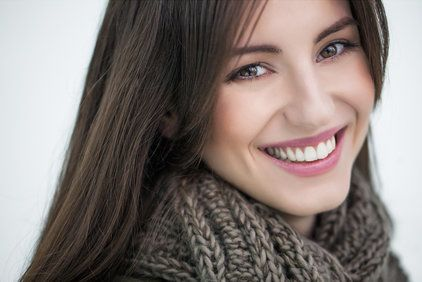 Woman smiling with straight, white teeth