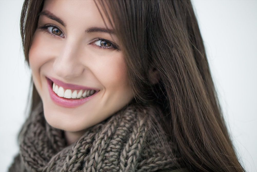 Smiling brunette woman wearing a scarf