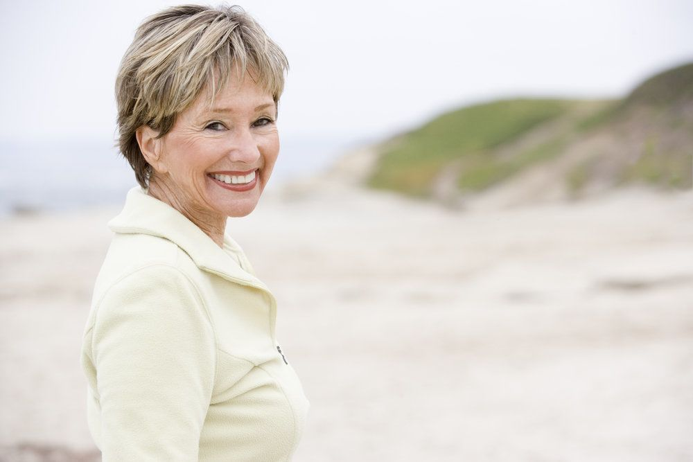A woman outside smiling