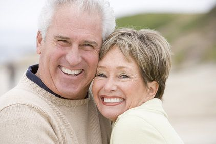 Middle-aged couple smiling together outdoors