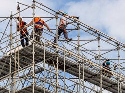 Construction workers on top of scaffolding