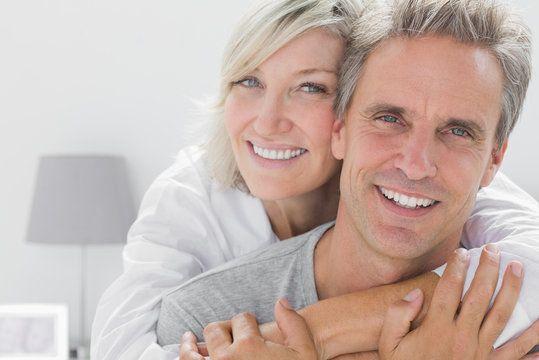 Couple hugging indoors