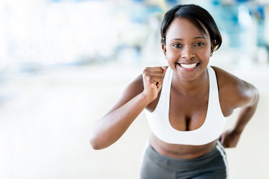 A smiling woman in exercise apparel