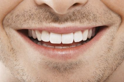 Close up of man's smile and stubble