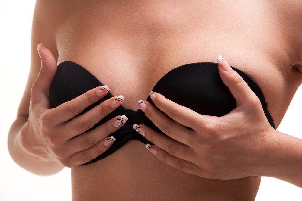 A woman cupping her breasts