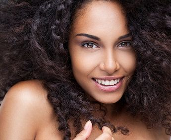 Beautiful, curly-haired woman with perfect skin