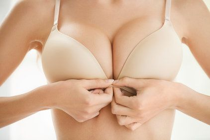 Woman with large breasts clasping front-closure bra