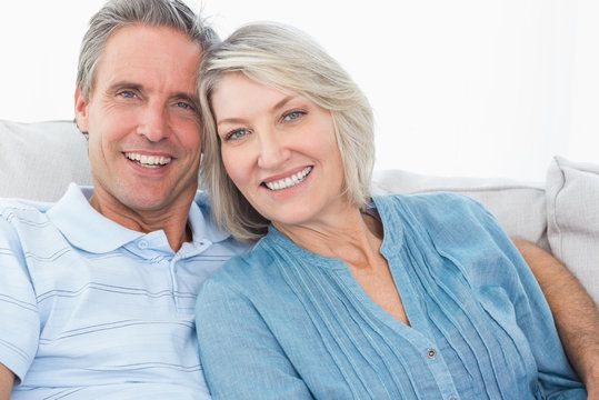 Mature couple spending time on the couch