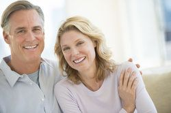 An older couple with complete and healthy smiles