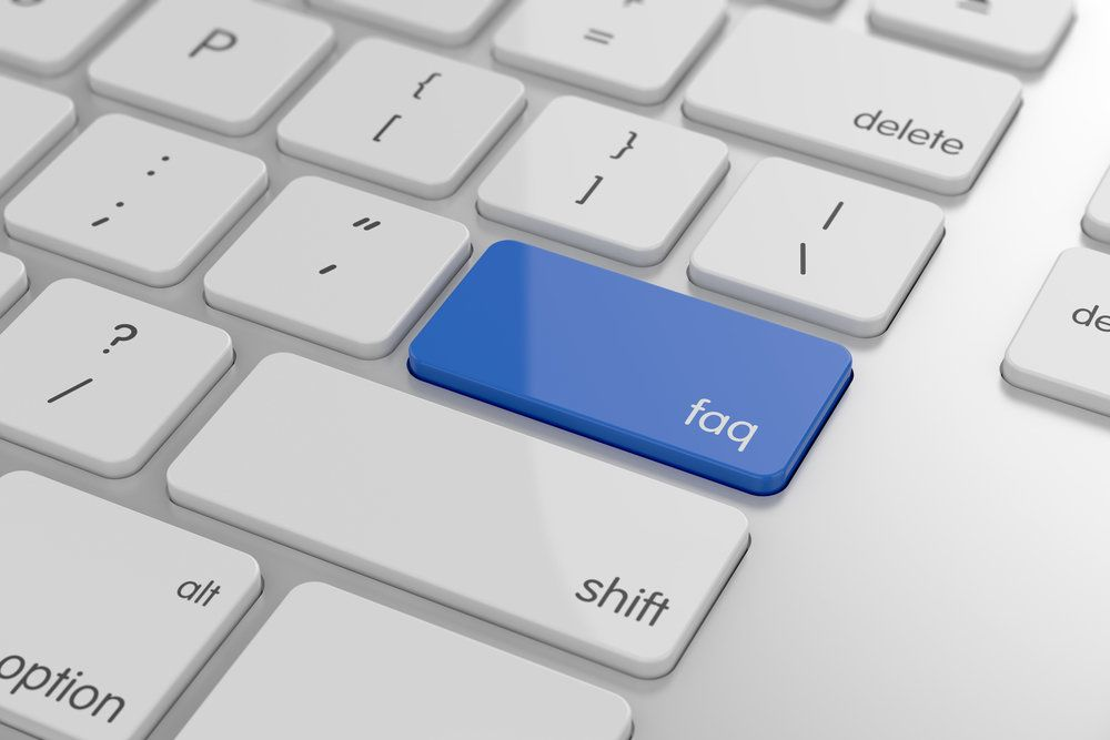 An FAQ button on a laptop keyboard