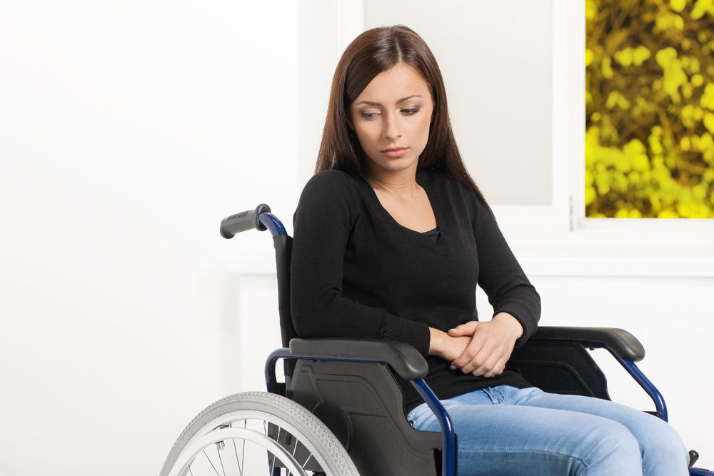 Depressed female sitting in a wheelchair