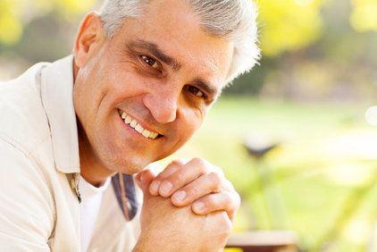 An older man, smiling