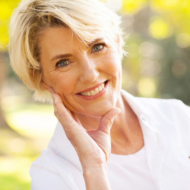 An older blonde woman with a healthy smile