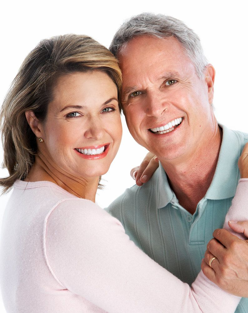 Man and woman in an embrace, their smiles bright and healthy after the placement of Prettau® Bridges
