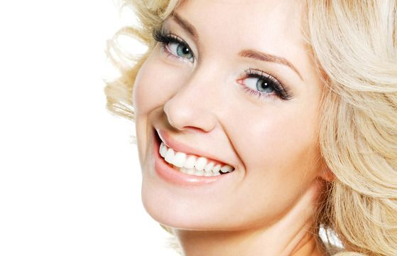 Happy blonde lady after teeth bleaching