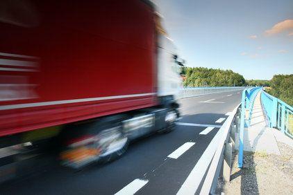 Big rig truck speeding along a highway road