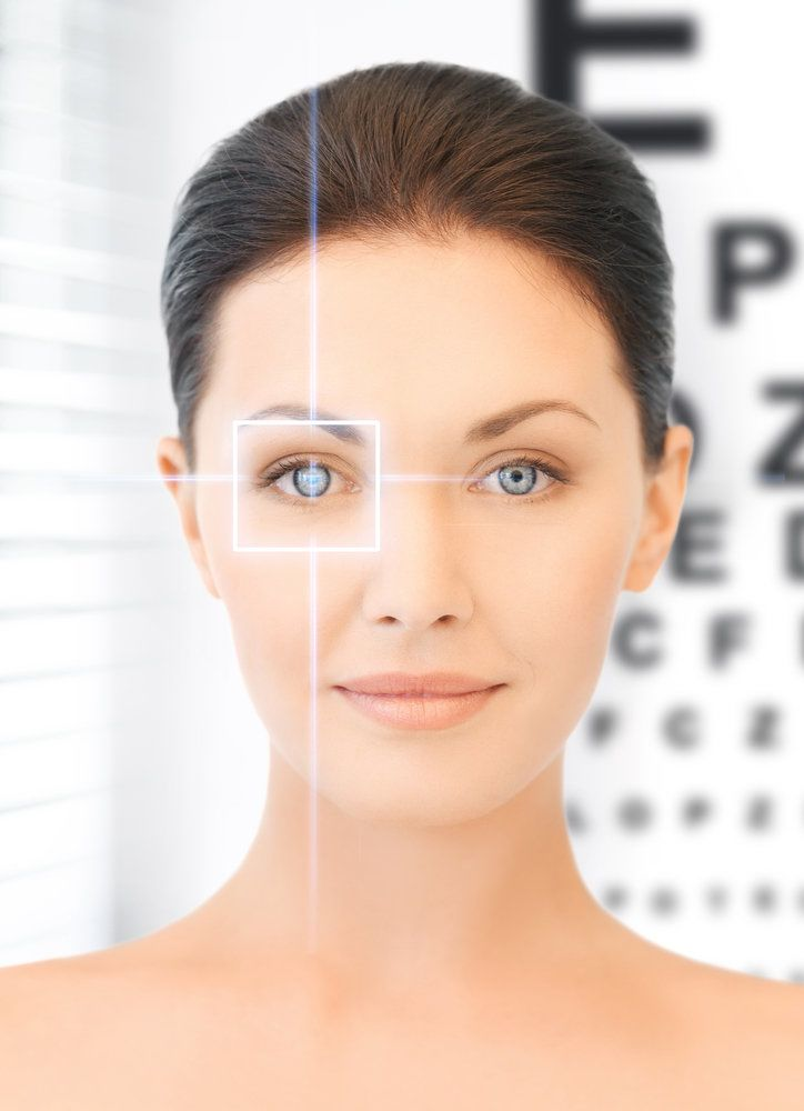 Woman in front of eye chart with graphic overlay on face