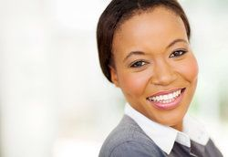 Smiling businesswoman with hair pulled back in bun