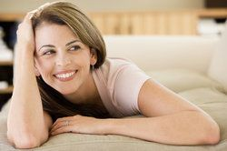 A woman smiling while at home