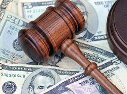 A gavel atop of stack of money to represent damages sought in lawsuits