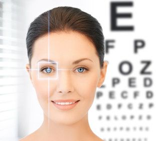 Woman standing in front of eye chart with illustrated box over one eye