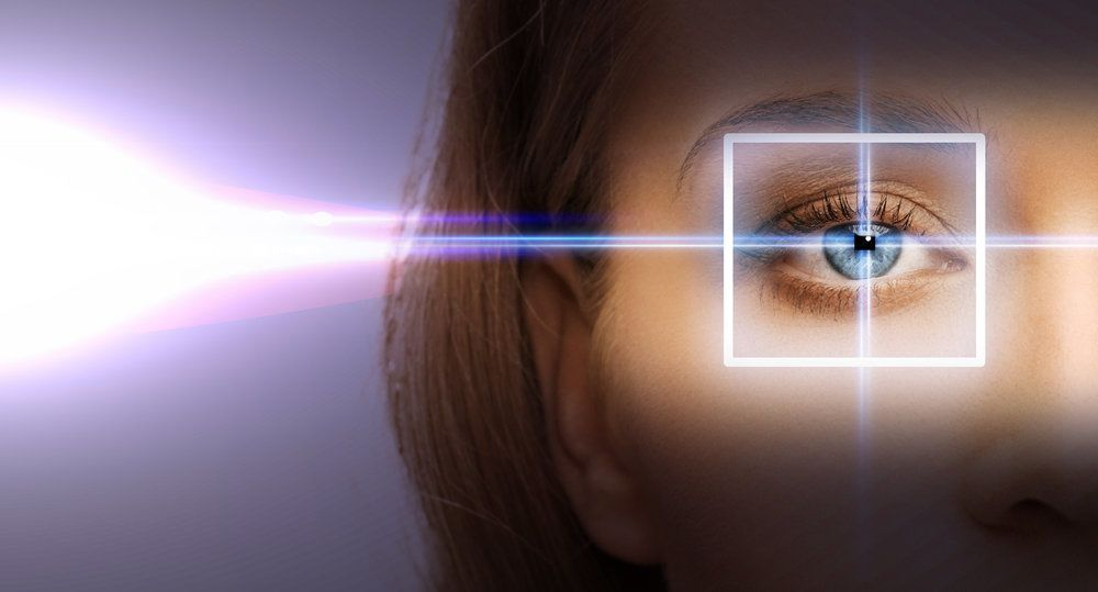 A woman's eye highlighted by a laser frame