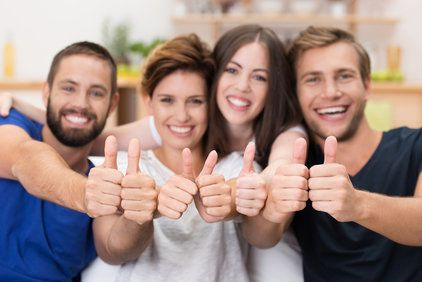 A group of people with their thumbs up
