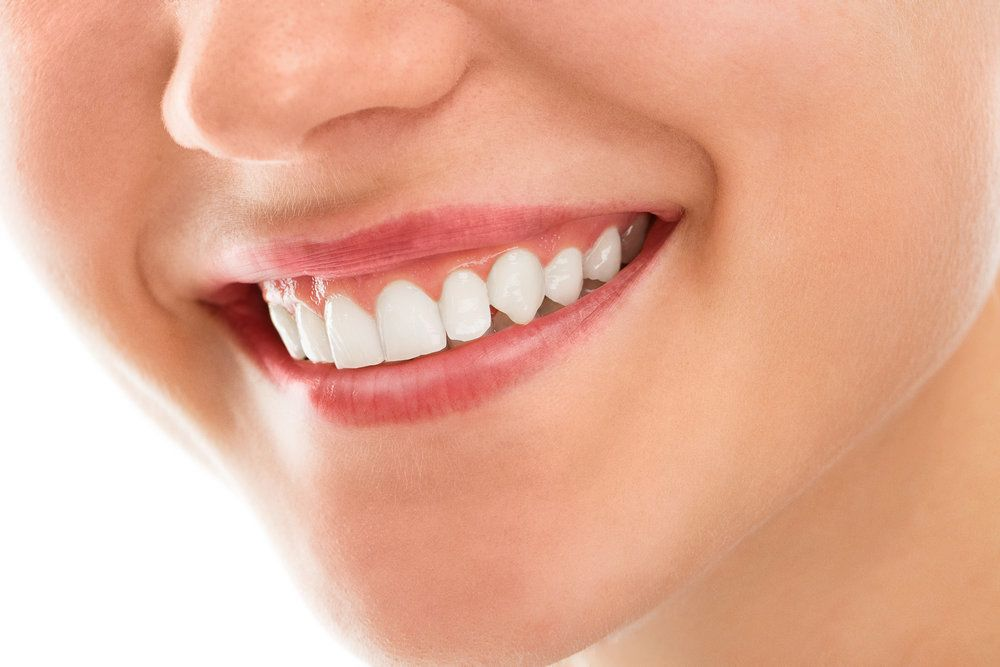 Upclose shot of woman's mouth with healthy pink gums.