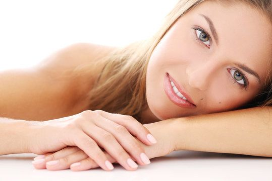 Smiling woman resting cheek on her forearm