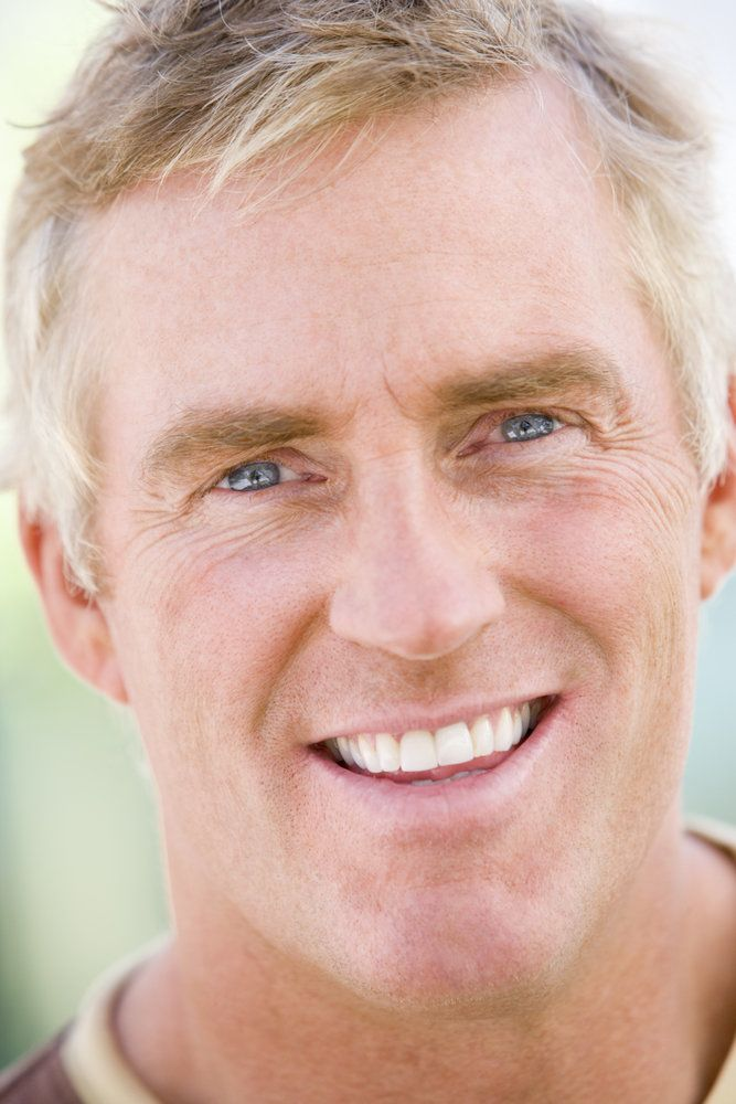 Smiling middle-aged man with straight, white teeth