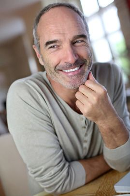 An older man with an attractive and healthy smile