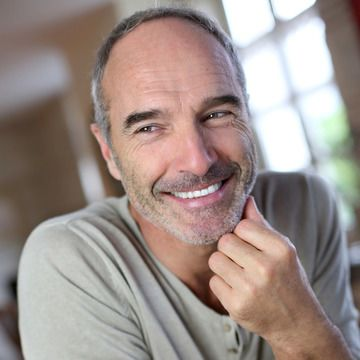 Middle aged man smiling in living room