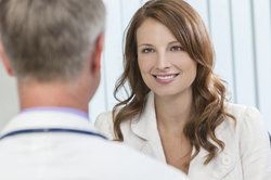 A woman speaking with a doctor