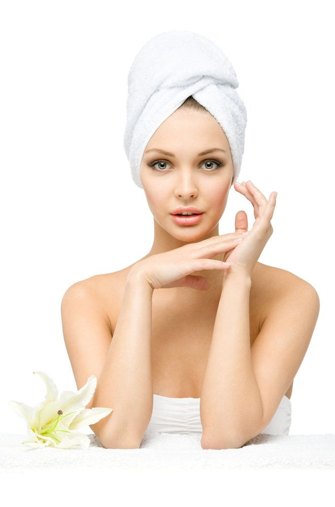 Beautiful woman in spa towels