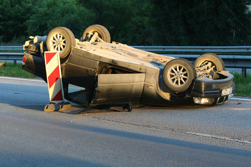 An overturned car after an accident caused by defective tires