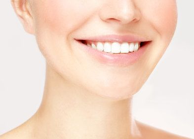 Close up of woman's very white smile